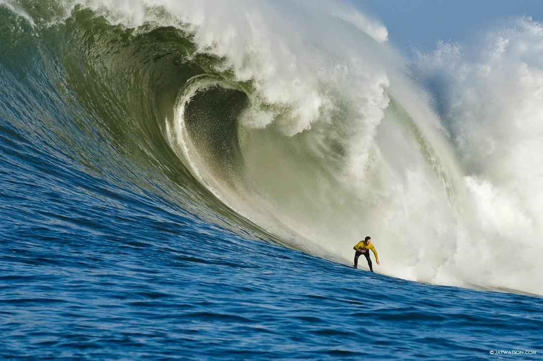 Ion Banner surfing a big wave at Mavericks in Half Moon Bay, CA