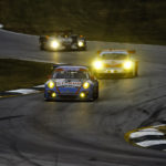 Porsche teams racing at dusk at Road Atlanta