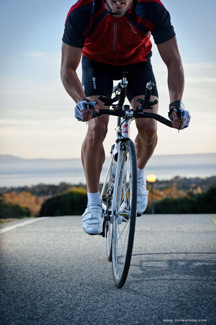 Triathlete Eric Clarkson cycling in Santa Cruz, CA