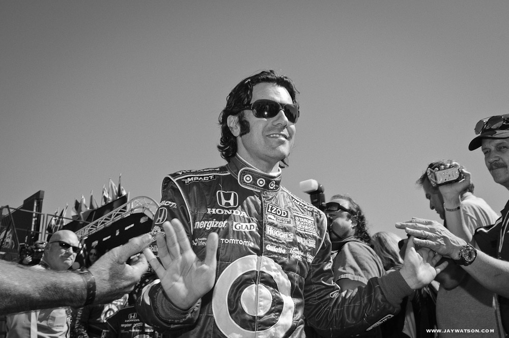 Dario Franchitti works the crowd.