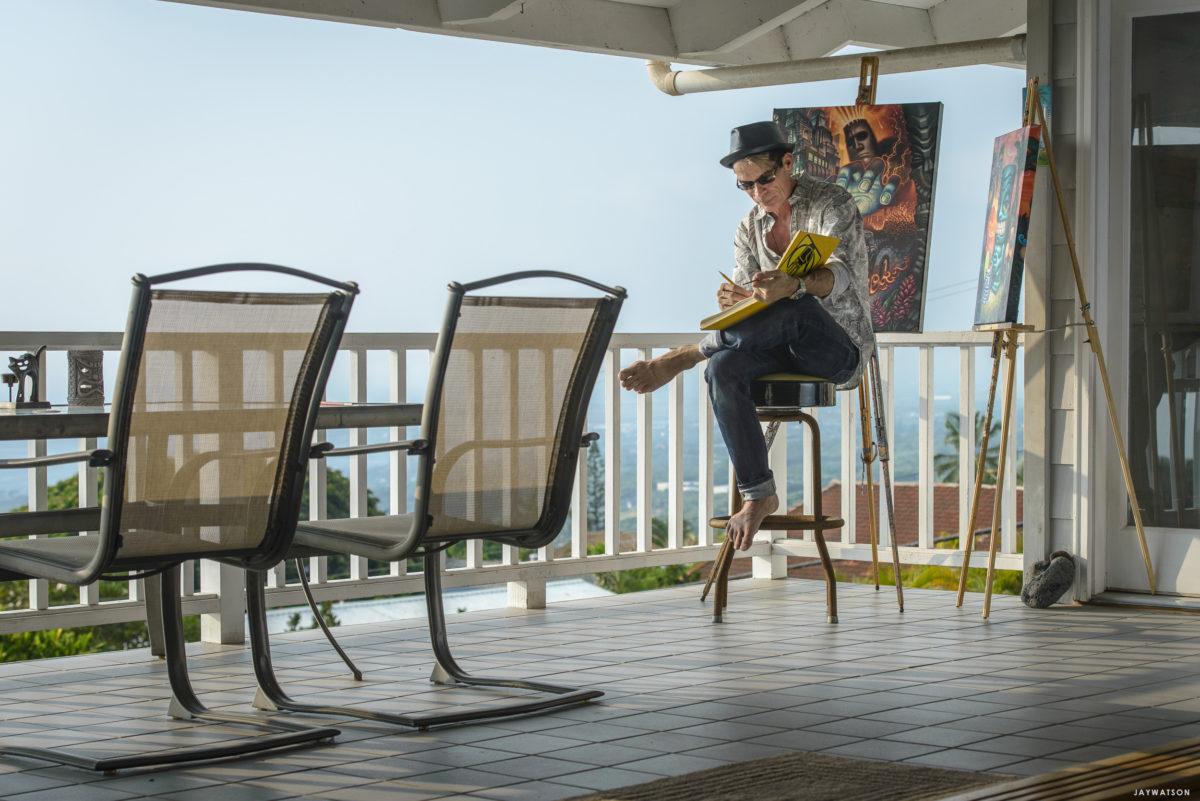 Tiki artist Brad Parker working at home.